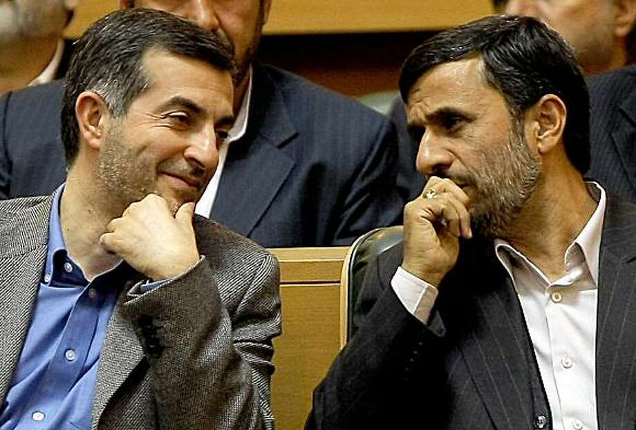 """(FILES) A picture taken on April 14, 2009 shows Iranian President Mahmoud Ahmadinejad (R) sitting next to his aide Esfandiar Rahim Mashaie (L) as they attend the Iranian expatriates summit in Tehran. Ahmadinejad has appointed Mashaie as the country's new first vice president, the official IRNA news agency reported on July 17, 2009. Mashaie, a confidant of Ahmadinejad, is a controversial figure who last year was rapped by the country's hardliners and by supreme leader Ayatollah Ali Khamenei for saying Iran is a """"friend of the Israeli people."""" AFP PHOTO/BEHROUZ MEHRI (Photo credit should read BEHROUZ MEHRI/AFP/Getty Images) Photo: Behrouz Mehri, AFP/Getty Images"""