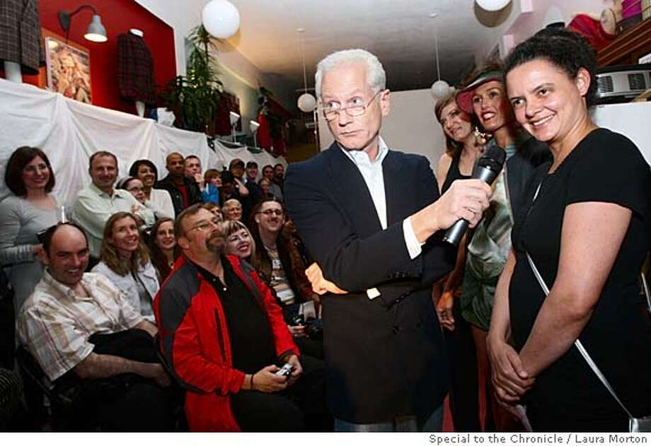 """###Live Caption:Arturo Galster (center) as Tim Gunn interviews designer Rachel Gibbs while hosting """"Project Lameway"""" a fashion competition spoofing the popular series Project Runway at RetroFit Vintage Store in San Francisco, Calf. on Wednesday, March 5, 2008. Photo by Laura Morton / Special to The Chronicle###Caption History:Arturo Galster (center) as Tim Gunn interviews designer Rachel Gibbs while hosting """"Project Lameway"""" a fashion competition spoofing the popular series Project Runway at RetroFit Vintage Store in San Francisco, Calf. on Wednesday, March 5, 2008. Photo by Laura Morton / Special to The Chronicle###Notes:Arturo Galster  Rachel Gibbs###Special Instructions: Photo: Laura Morton"""