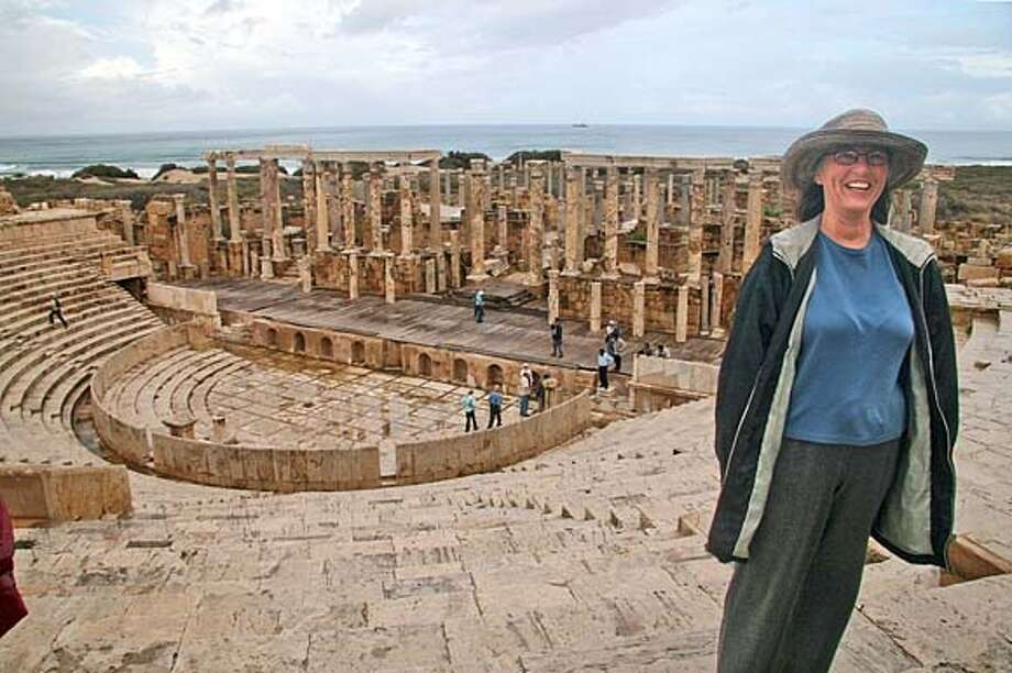 "###Live Caption:TRAVEL JUSTBACK -- Libya.jpg 10/17/07 in , .  TRAVEL JUSTBACK -- Libya.jpg Laurie McAndish King, Novato Email: laurie@laurieking.com Daytime phone number: (415) 209-6325 Just back from: Libya I went because: Because I could. Libya recently resumed issuing visitors' visas for Americans, and I wanted to see the country now that it has renounced weapons of ma Don't miss: Some of the best archaeological sites in the world. Leptis Magna and Cyrene are magnificent but overwhelming; Sabratha and Apollonia are more intimate Don't bother: Benghazi, which is currently experiencing ""unrest."" Coolest souvenir: Great Leader wristwatches. Also, The Green Book explaining Colonel Gaddafi's approach to democracy. Worth a splurge: Honestly, there isn't much opportunity for splurging in The Great Socialist People's Libyan Arab Jamahiriya (the country's official name). I wish I'd packed: Glad I took plastic sandals. They kept me cool in the heat, and weren't ruined by the floods. Other comments: Pack a Polaroid and film; the people are friendly (not pushy) and love to have their pictures taken with Westerners (be sure to ask first). Details of attached photo (if sent): Laurie McAndish King at Leptis Magna###Caption History:TRAVEL JUSTBACK -- Libya.jpg  Laurie McAndish King, Novato Email: laurie@laurieking.com  Daytime phone number: (415) 209-6325 Just back from: Libya I went because: Because I could. Libya recently resumed issuing visitors' visas for Americans, and I wanted to see the country now that it has renounced weapons of ma Don't miss: Some of the best archaeological sites in the world. Leptis Magna and Cyrene are magnificent but overwhelming; Sabratha and Apollonia are more intimate Don't bother: Benghazi, which is currently experiencing ""unrest."" Coolest souvenir: Great Leader wristwatches. Also, The Green Book explaining Colonel Gaddafi's approach to democracy. Worth a splurge: Honestly, there isn't much opportunity Photo: None"