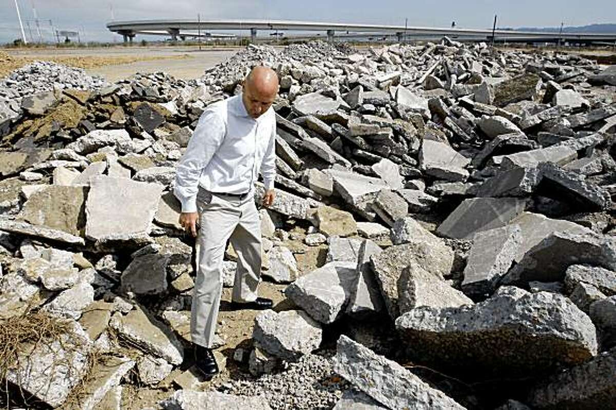 John Monetta, property manager of the city of Oakland's parcels of land on the old Oakland Army Base site, visits the Central Gateway location in Oakland, Calif., on Friday, July 10, 2009. The land is currently being used as a storage site for demolition projects.