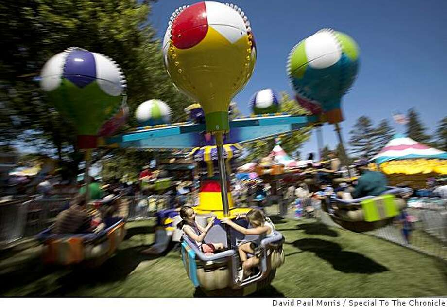 People ride on the Balloon Samba Ride at the Alameda County Fair July 3, 2009 in Pleasanton, Calif. The Balloon Samba ride was a ride that was formally at Michael Jackson's Neverland Ranch. (Photograph by David Paul Morris/Special to The Chronicle) Photo: David Paul Morris, Special To The Chronicle