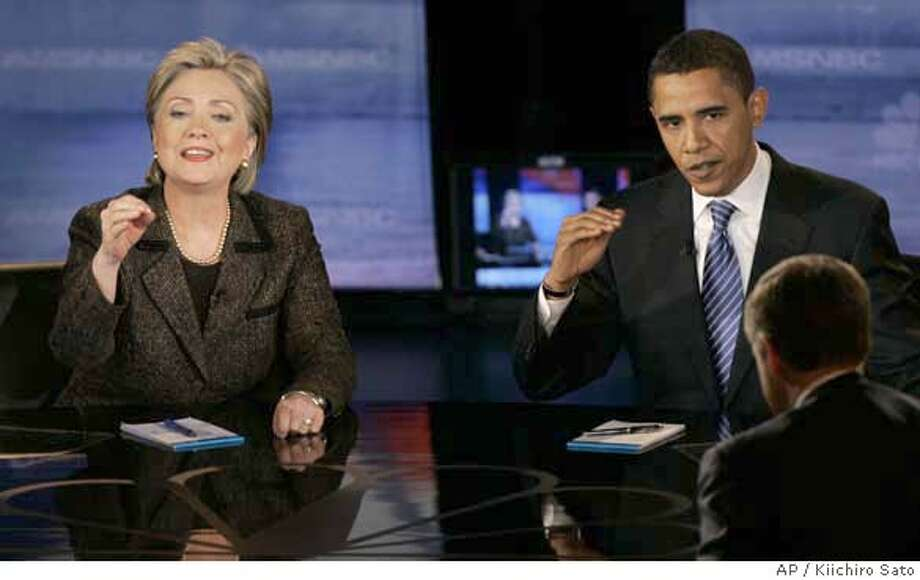 Democratic presidential hopefuls Sen. Hillary Rodham Clinton, D-N.Y., left, and Sen. Barack Obama, D-Ill., respond to a question during a Democratic presidential debate Tuesday, Feb. 26, 2008, in Cleveland. (AP Photo/Kiichiro Sato) Photo: Kiichiro Sato