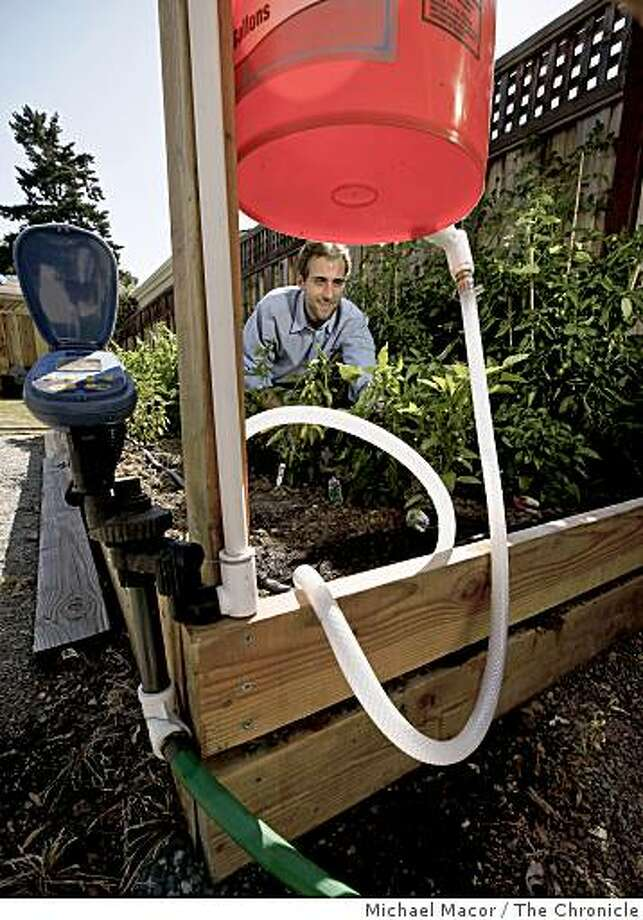 Peter Frykman is the founder and CEO of DripTech, a company with technology that was developed at Stanford to bring an affordable irrigation system to the poorest farmers of the world, in his test garden displays the system on Wednesday June 24, 2009, in Palo Alto, Calif. Photo: Michael Macor, The Chronicle