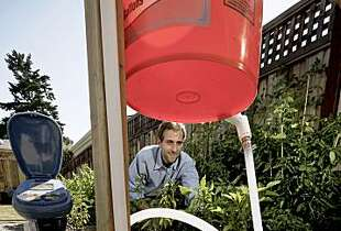 Peter Frykman is the founder and CEO of DripTech, a company with technology that was developed at Stanford to bring an affordable irrigation system to the poorest farmers of the world, in his test garden displays the system on Wednesday June 24, 2009, in Palo Alto, Calif.
