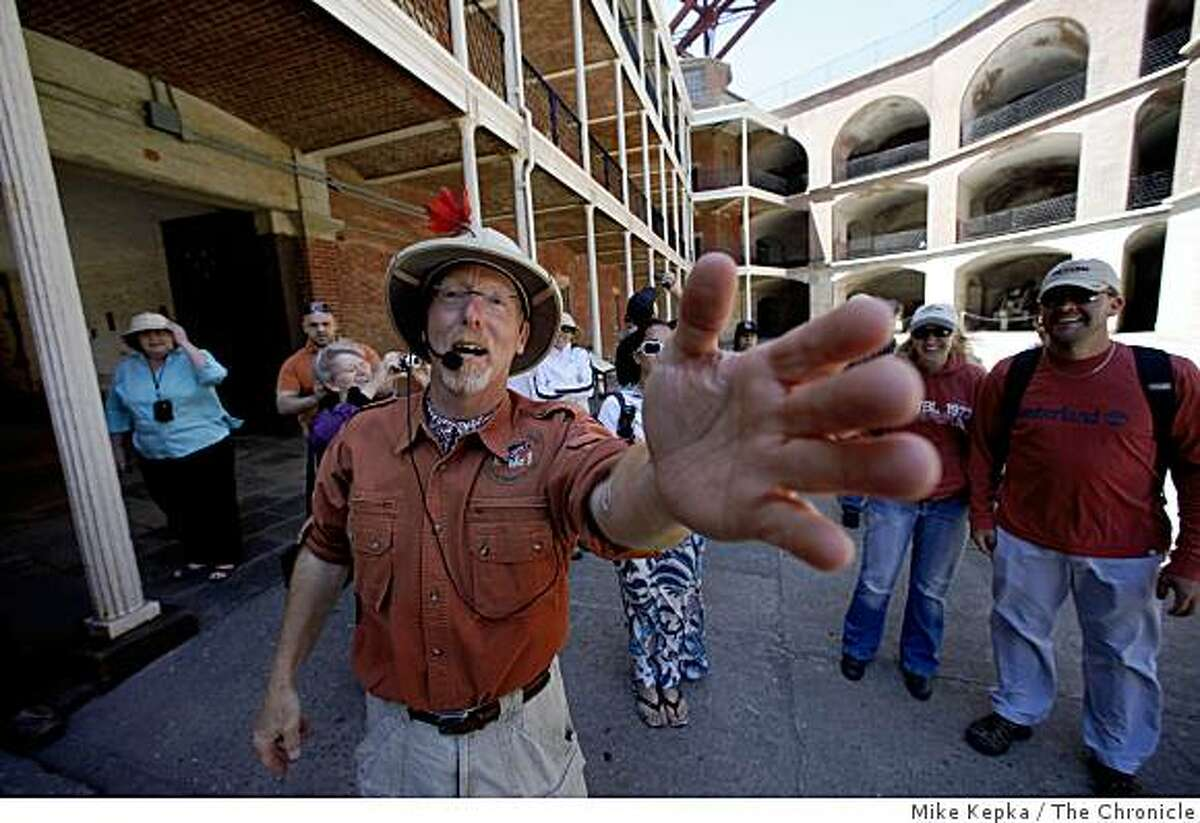 Daniel Oppenheim, Cheif Expedition Officer for Urban Safari, leads a group of tourists through Fort Point under the Golden Gate Bridge on Monday July 6, 2009 in San Francisco, Calif.