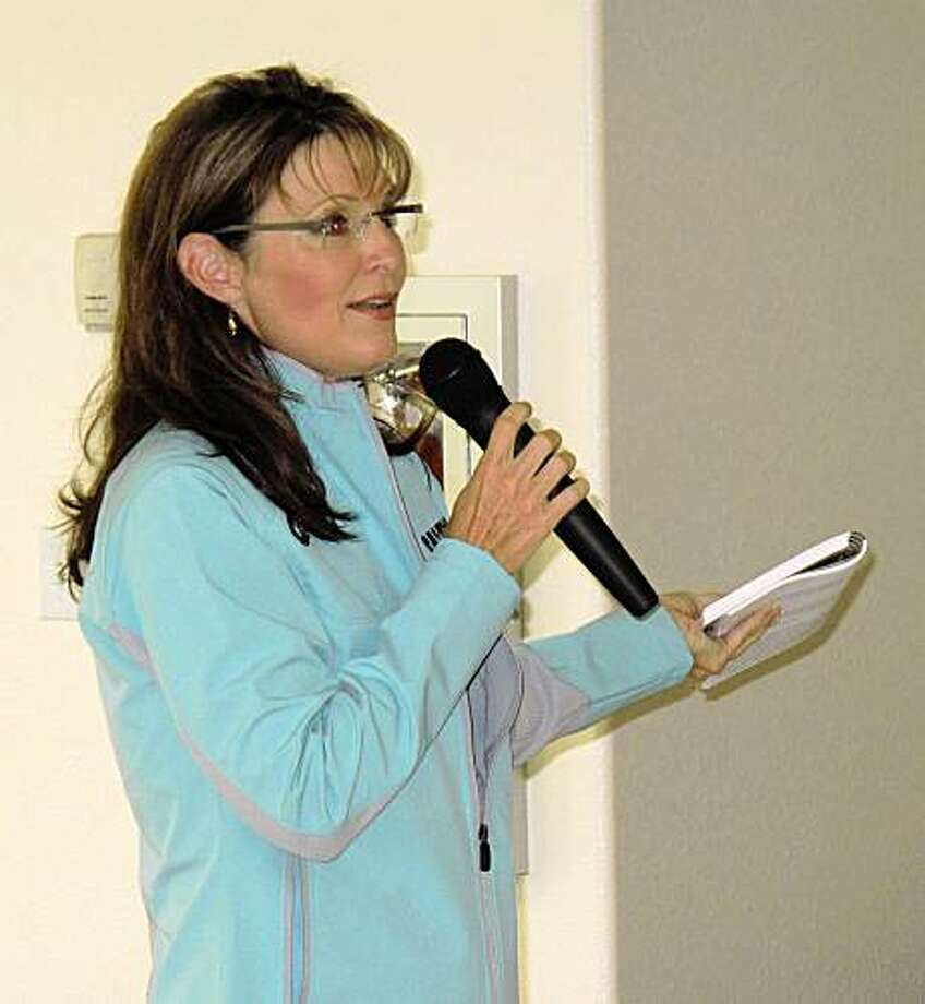 Alaska Gov. Sarah Palin addresses about 100 people who showed up to a bill signing ceremony in Unalakleet, Alaska, on Friday, July 17, 2009. (AP Photo/Matthew Daly) Photo: Matthew Daly, AP