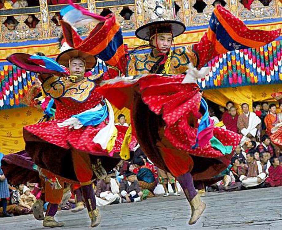 Monks perform a black hat dance, a dance of ground purification, during the first day of the Tsechu festival at the Punakha Dzong, Friday, Feb. 18, 2005 in the Punakha district, Bhutan. Photo: Lisa Poole, AP