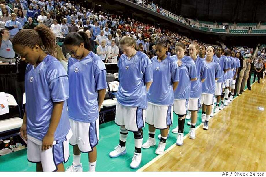 ###Live Caption:North Carolina players bow their heads in a moment of silence for slain University of North Carolina student body president Eve Carson before a women's ACC tournament basketball game at the Greensboro Coliseum in Greensboro, N.C., Friday, March 7, 2008. (AP Photo/Chuck Burton)###Caption History:North Carolina players bow their heads in a moment of silence for slain University of North Carolina student body president Eve Carson before a women's ACC tournament basketball game at the Greensboro Coliseum in Greensboro, N.C., Friday, March 7, 2008. (AP Photo/Chuck Burton)###Notes:###Special Instructions:EFE OUT Photo: Chuck Burton