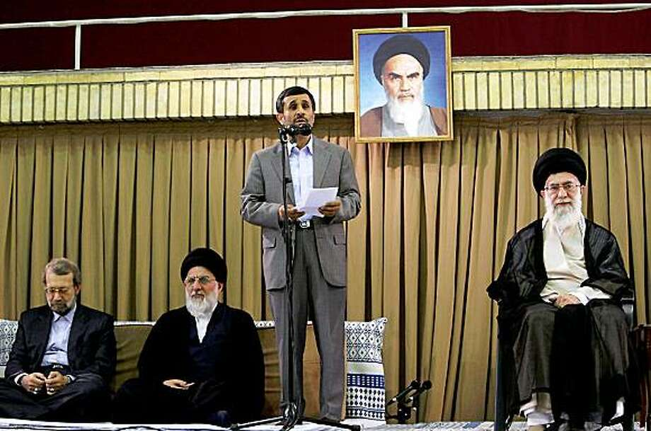 A handout picture posted on the Iranian supreme leader's website shows Iranian President Mahmoud Ahmadinejad (C) speaking during a ceremony attended by Iran's supreme leader Ayatollah Ali Khamenei (R), Parliament Speaker Ali Larijani (L) and judiciary chief Ayatollah Mahmoud Hashemi Shahrudi in Tehran on July 20, 2009. Khamenei accused the enemies of the Islamic republic of fomenting the crisis over last month's disputed presidential election, state television reported on July 20. Portrait shows Iran's late revolutionary founder Ayatollah Ruhollah Khomeini. AFP PHOTO/HO == RESTRICTED TO EDITORIAL USE == (Photo credit should read -/AFP/Getty Images) Photo: -, AFP/Getty Images