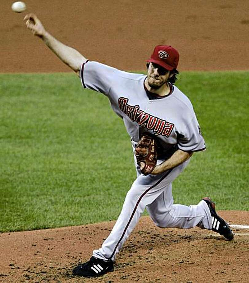 Arizona Diamondbacks starting pitcher Dan Haren throws during the sixth inning of a baseball game against the St. Louis Cardinals Saturday, July 18, 2009, in St. Louis. The Diamondbacks won 4-2. (AP Photo/Jeff Roberson) Photo: Jeff Roberson, AP