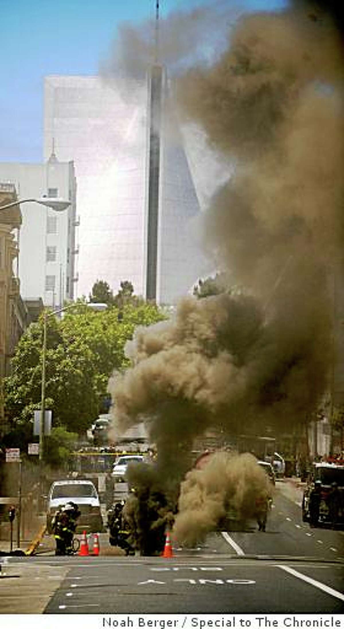Firefighters fight an underground fire on O'Farrell Street in San Francisco on June 5, 2009. The underground explosion and fire in Tenderloin cut off power to 3,200 people, trapped some in elevators, and prompted a shelter-in-place order.