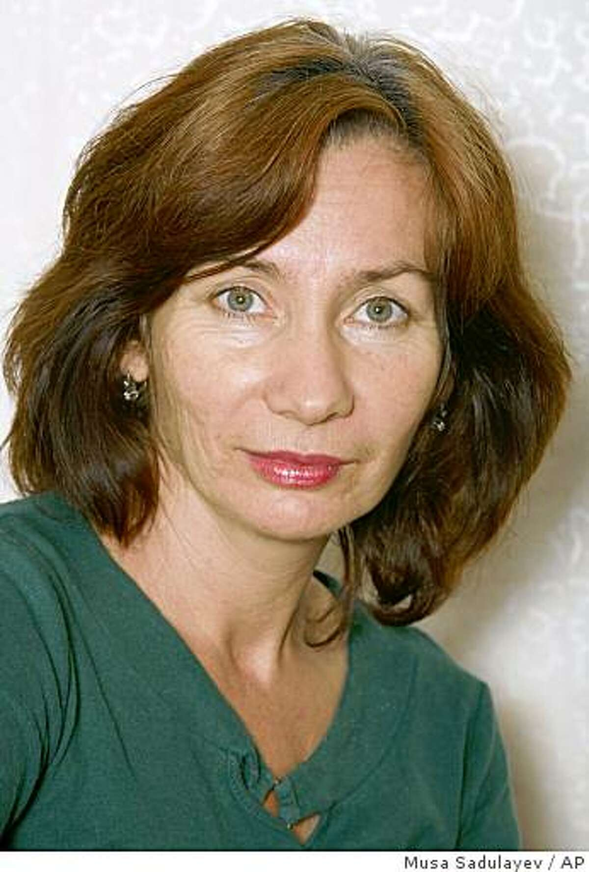 FILE - In this Sept. 15, 2007 file photo Natalya Estemirova, a human rights activist, seen in the Chechen capital, Grozny, southern Russia. Natalya Estemirova, a prominent human rights advocate, was kidnapped and killed in Chechnya Wednesday July 15, 2009. Her body with gunshot wounds was found in the neighboring region of Ingushetia. (AP Photo/Musa Sadulayev)