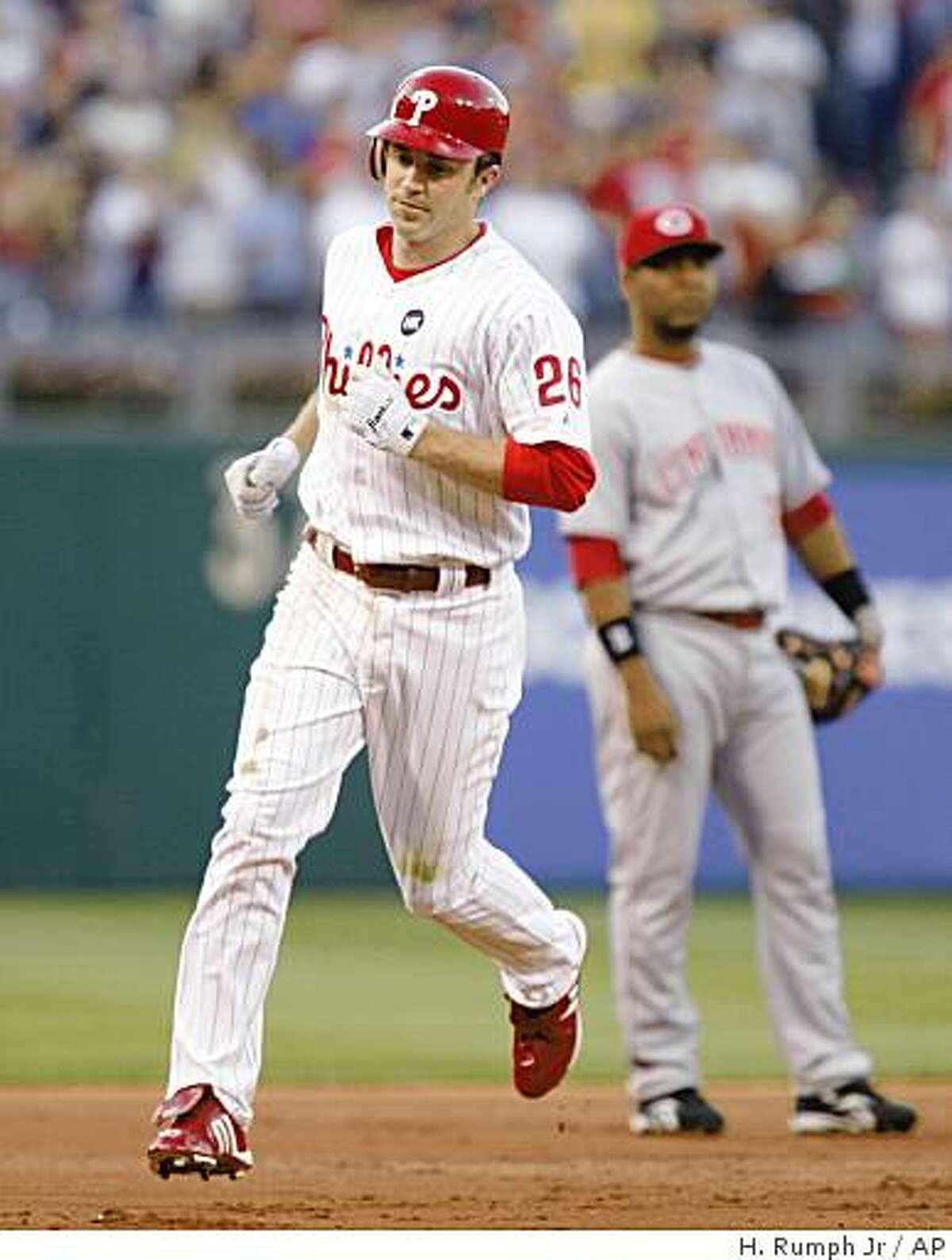 Philadelphia Phillies' Chase Utley (26) runs the bases after hitting a three-run home run against the Cincinnati Reds' in the first inning of a baseball game Monday, July 6, 2009, in Philadelphia. (AP Photo/H. Rumph Jr.)