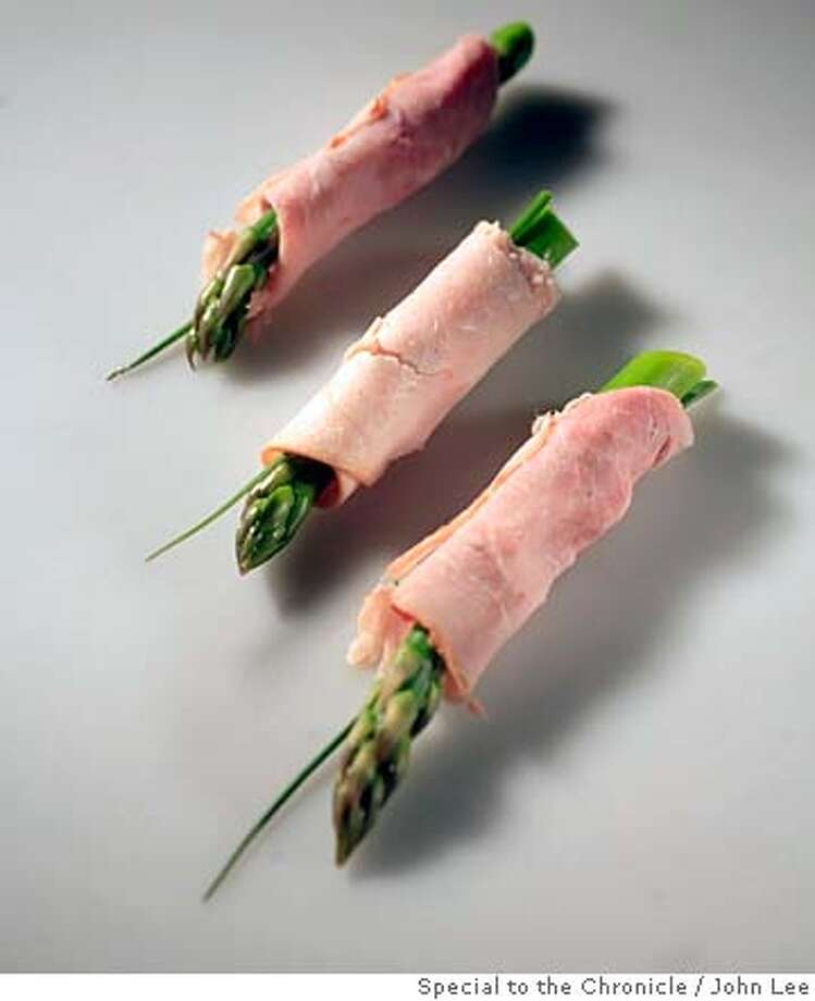 ###Live Caption:SN29_SNAK_02_JOHNLEE.JPG  Asparagus spear wrapped in ham.  By JOHN LEE/SPECIAL TO THE CHRONICLE###Caption History:SN29_SNAK_02_JOHNLEE.JPG  Asparagus spear wrapped in ham.  By JOHN LEE/SPECIAL TO THE CHRONICLE###Notes:###Special Instructions: Photo: John Lee