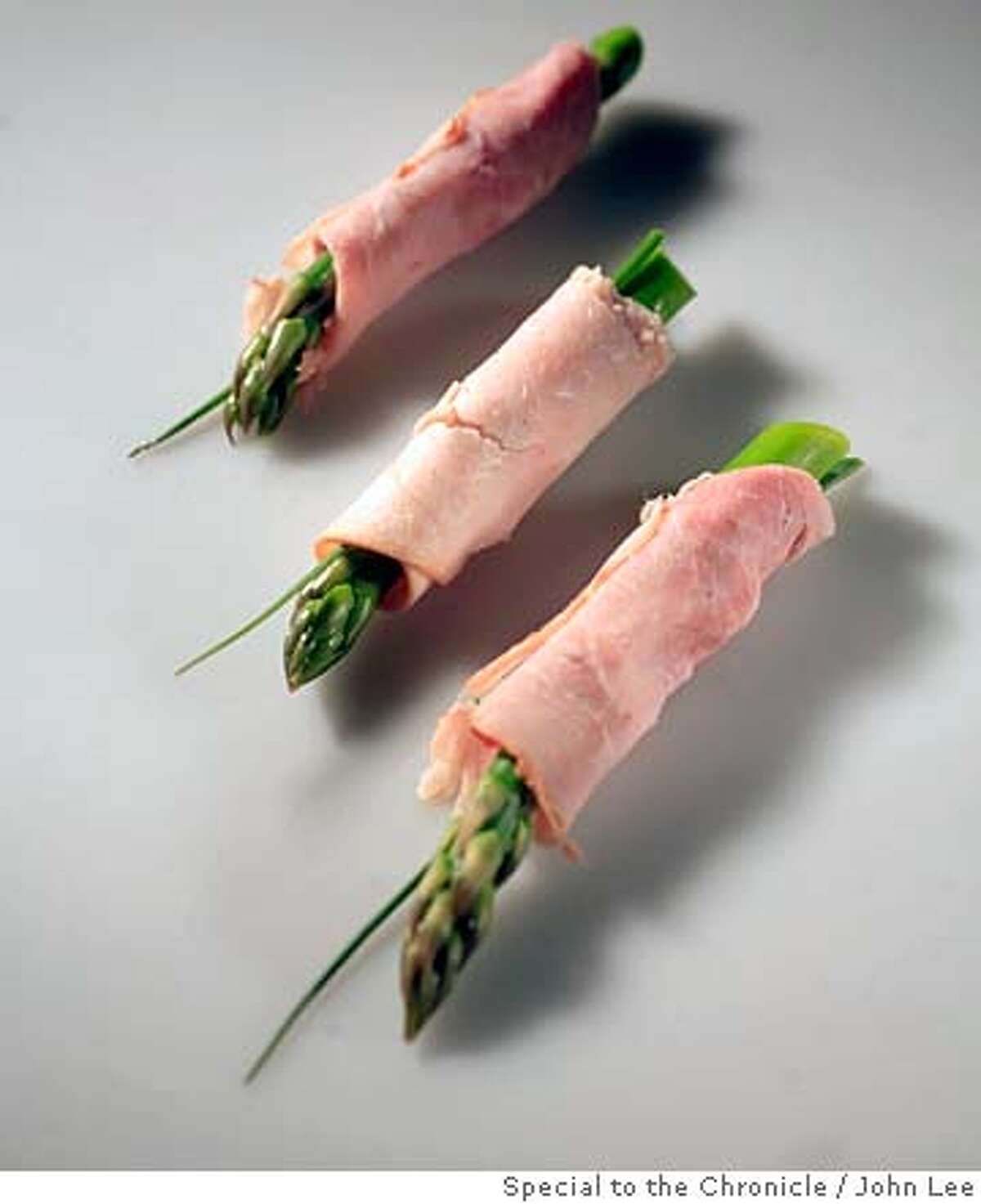 ###Live Caption:SN29_SNAK_02_JOHNLEE.JPG Asparagus spear wrapped in ham. By JOHN LEE/SPECIAL TO THE CHRONICLE###Caption History:SN29_SNAK_02_JOHNLEE.JPG Asparagus spear wrapped in ham. By JOHN LEE/SPECIAL TO THE CHRONICLE###Notes:###Special Instructions: