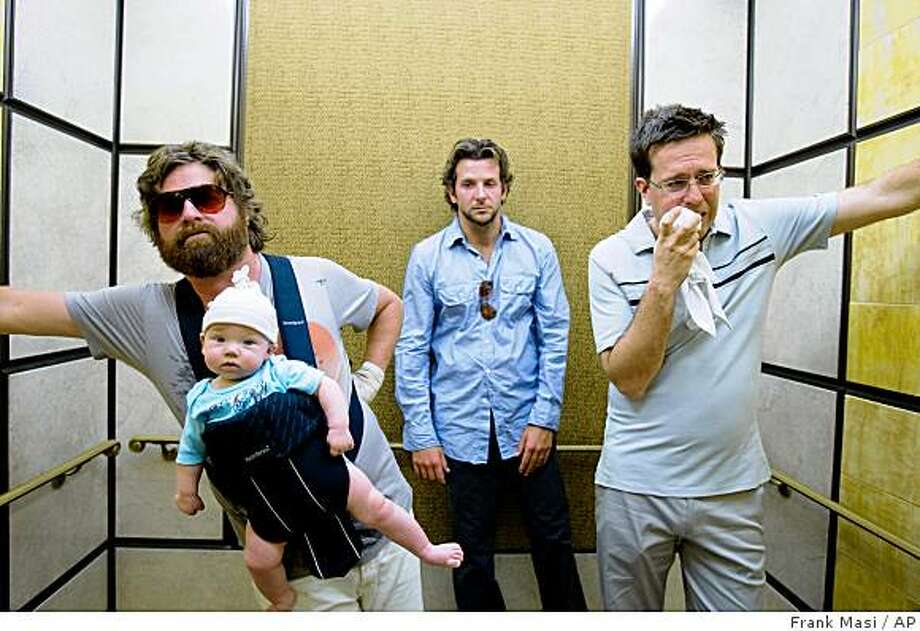 "In this film publicity image released by Warner Bros., Zach Galifianakis, left, Bradley Cooper, center, and Ed Helms are shown in a scene from ""The Hangover."" Photo: Frank Masi, AP"