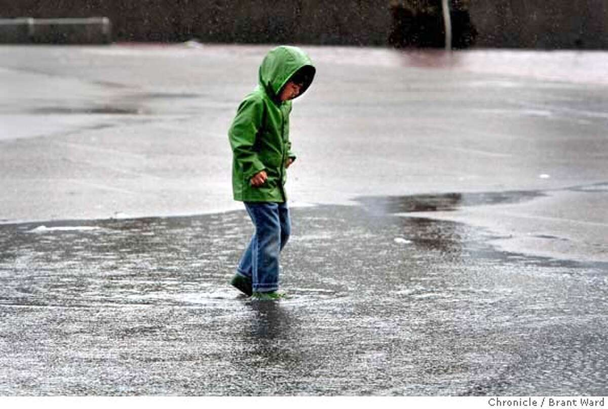 Six year old Lio McAllister negotiated a big puddle in Justin Herman Plaza Sunday morning as he took a walk with his family. Weather reports had called for a fierce storm which failed to materialize. (2/24/2008) (Photo by Brant Ward/San Francisco Chronicle)