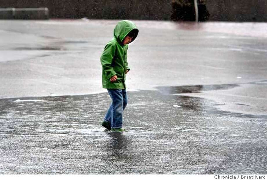 Six year old Lio McAllister negotiated a big puddle in Justin Herman Plaza Sunday morning as he took a walk with his family. Weather reports had called for a fierce storm which failed to materialize. (2/24/2008) (Photo by Brant Ward/San Francisco Chronicle) Photo: Brant Ward