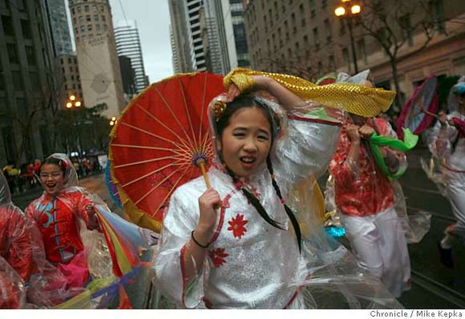 Bonnie Young, 11, from the Chinese American International School, tries to hold onto her costume on Market Street at the start of the Chinese New Years parade on Saturday, Feb. 23, 2008 in San Francisco, Calif. Photo by Mike Kepka / San Francisco Chronicle Ran on: 02-24-2008  Bonnie Young, 11, of the Chinese American International School, tries to hold on to her costume at the Chinese New Year's Parade. Parade coverage begins on B1. More photos at sfgate.com-cny.  Ran on: 02-24-2008  Bonnie Young, 11, of the Chinese American International School, tries to hold on to her costume at the Chinese New Year's Parade. Parade coverage begins on B1. More photos at sfgate.com-cny. Photo: Mike Kepka