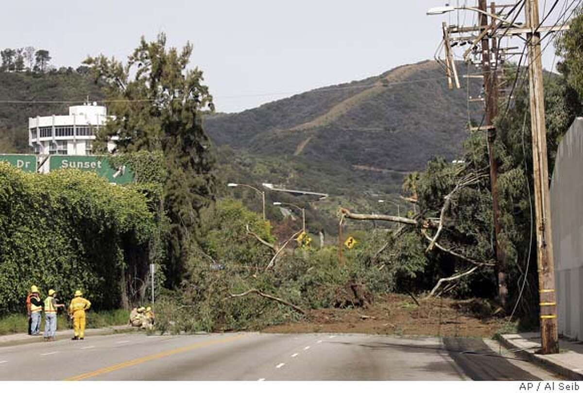 ###Live Caption:Officials view the debris after a hillside collapse sent tons of earth and trees crashing onto a busy road during rush-hour Thursday morning, leaving a house in danger of falling. The landslide closed both lanes of Sepulveda Boulevard in west Los Angeles Thursday morning, March 6, 2008. (AP Photo/Al Seib,pool)###Caption History:Officials view the debris after a hillside collapse sent tons of earth and trees crashing onto a busy road during rush-hour Thursday morning, leaving a house in danger of falling. The landslide closed both lanes of Sepulveda Boulevard in west Los Angeles Thursday morning, March 6, 2008. (AP Photo/Al Seib,pool)###Notes:###Special Instructions:POOL PHOTO