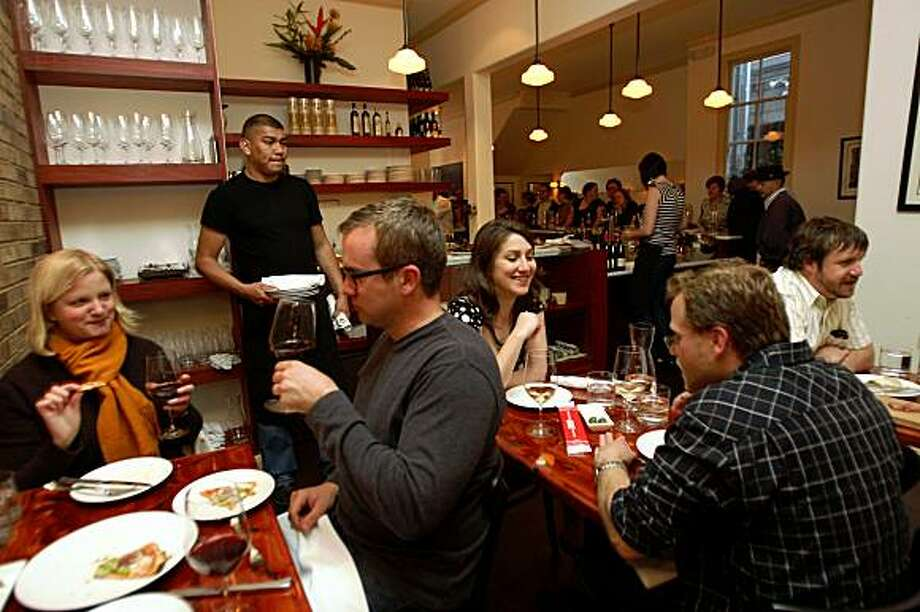 At left is Liz Evans and Pat Waters, and to their right is Maya Ingram and Seth Linden at Uva Enoteca, a new wine bar and eating place in the Lower Haight, in San Francisco, Calif., on Thursday, April 24, 2008. Photo: Liz Hafalia, The Chronicle