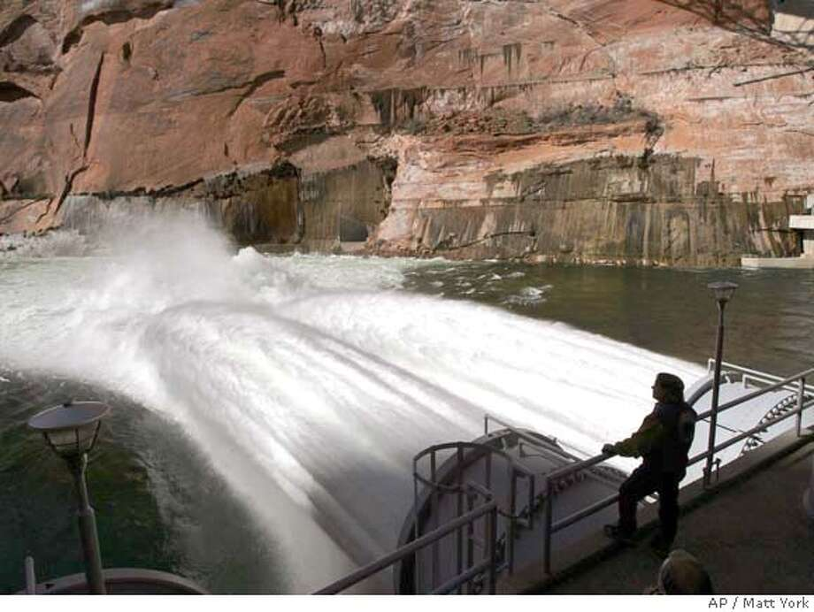###Live Caption:Water flows from the number one and two jet tubes at the Glen Canyon Dam Wednesday, March 5, 2008, in Page, Ariz. The Department of Interior is experimenting with high flows of water from the dam to help, in part, to rebuild beaches along the Colorado River that runs through the Grand Canyon. (AP Photo/Matt York)###Caption History:Water flows from the number one and two jet tubes at the Glen Canyon Dam Wednesday, March 5, 2008, in Page, Ariz. The Department of Interior is experimenting with high flows of water from the dam to help, in part, to rebuild beaches along the Colorado River that runs through the Grand Canyon. (AP Photo/Matt York)###Notes:###Special Instructions: Photo: Matt York