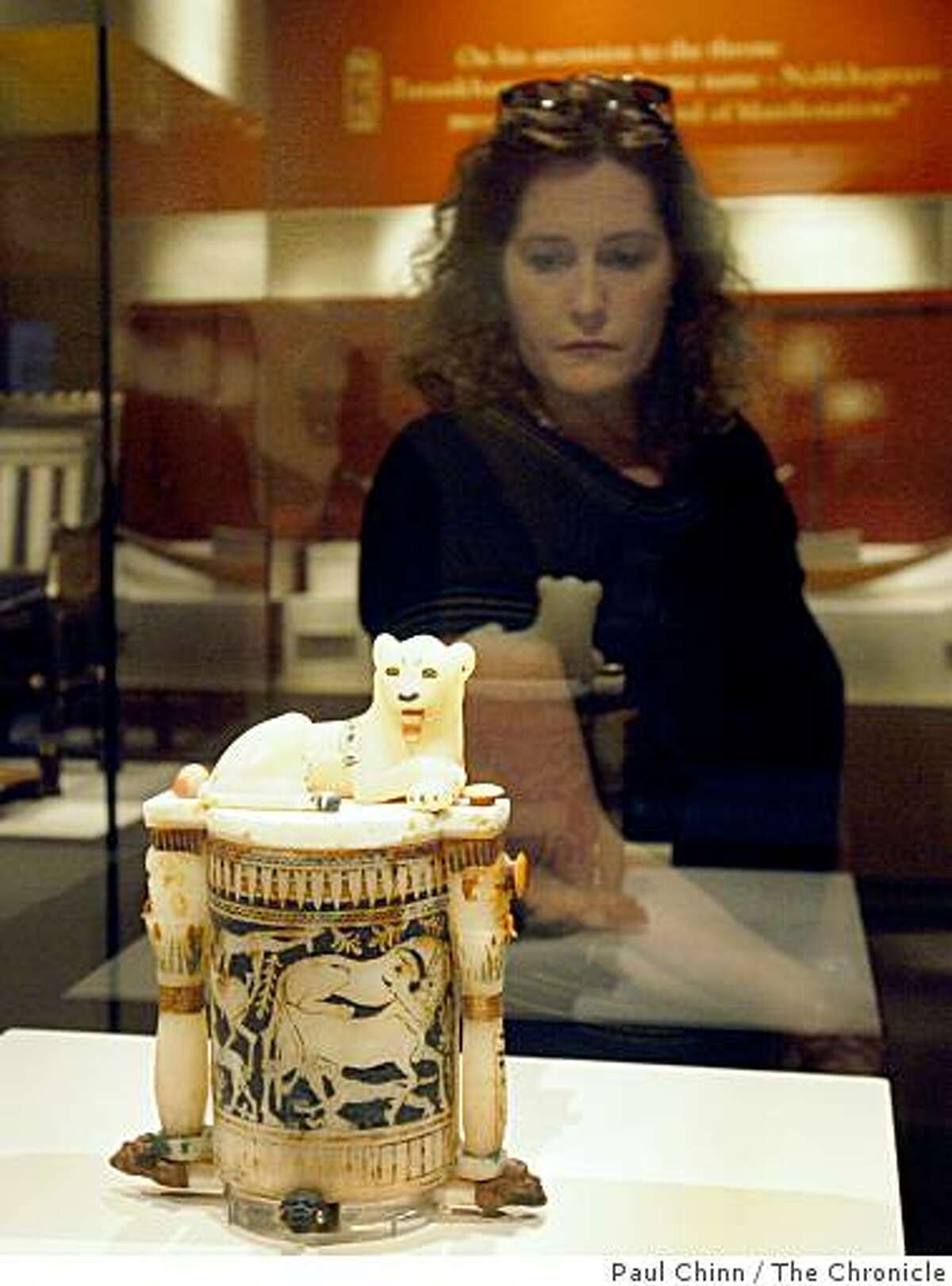 Sharon Grable of Sacramento views a lion cosmetic jar displayed in the King Tut exhibit, which opened to the public at the de Young Museum in San Francisco on Saturday.