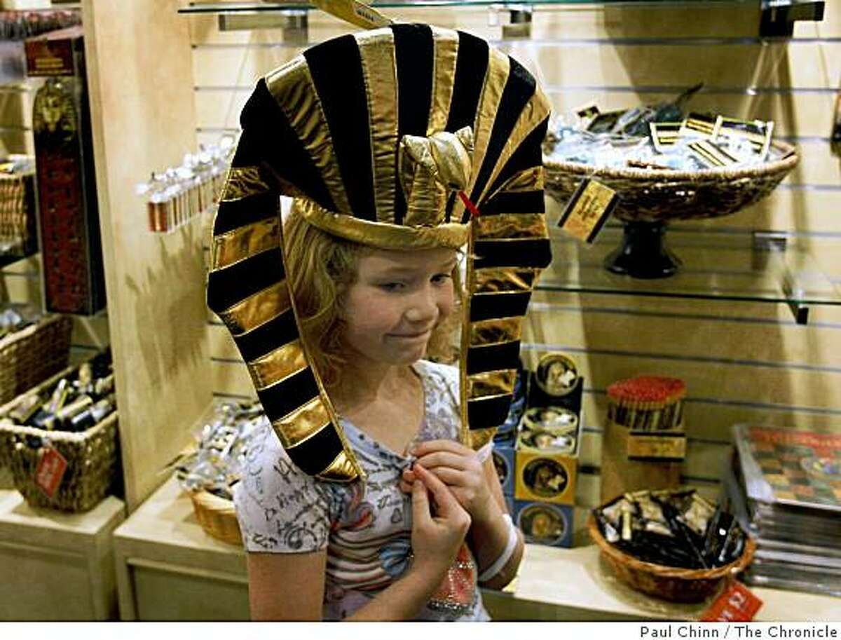 Katie Grable, 7, from Sacramento, tries on a Pharaoh-style headdress in the museum gift shop after seeing the King Tut exhibit at the de Young Museum in San Francisco, Calif., on Saturday, June 27, 2009.