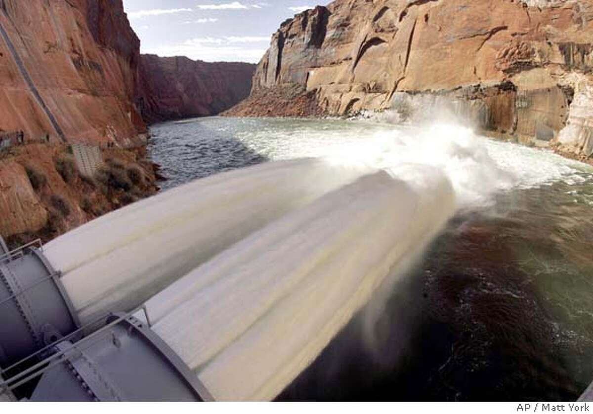 ###Live Caption:Water flows from the number one and two jet tubes at the Glen Canyon Dam Wednesday, March 5, 2008 in Page, Ariz. The Department of Interior is experimenting with high flows of water from the dam to help, in part, to rebuild beaches along the Colorado River that runs through the Grand Canyon. (AP Photo/Matt York)###Caption History:Water flows from the number one and two jet tubes at the Glen Canyon Dam Wednesday, March 5, 2008 in Page, Ariz. The Department of Interior is experimenting with high flows of water from the dam to help, in part, to rebuild beaches along the Colorado River that runs through the Grand Canyon. (AP Photo/Matt York)###Notes:###Special Instructions: