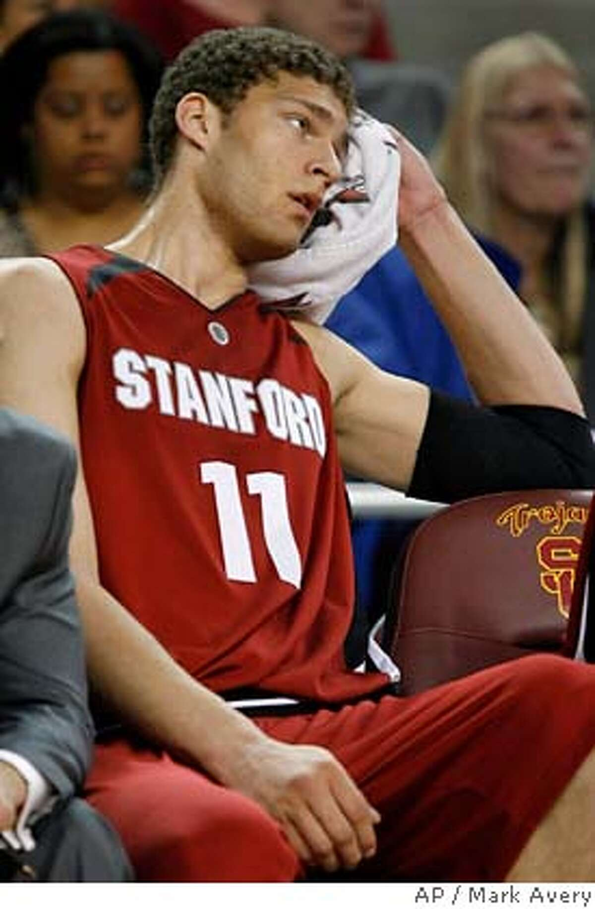 ###Live Caption:Stanford forward Brook Lopez sits on the bench in the closing minutes of Stanford's 77-64 loss to Southern California in a basketball game in Los Angeles on Saturday, March 8, 2008. (AP Photo/Mark Avery)###Caption History:Stanford forward Brook Lopez sits on the bench in the closing minutes of Stanford's 77-64 loss to Southern California in a basketball game in Los Angeles on Saturday, March 8, 2008. (AP Photo/Mark Avery)###Notes:Brook Lopez###Special Instructions:EFE OUT