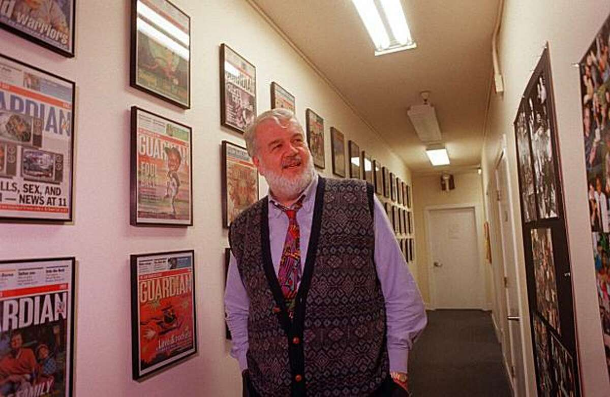 Editor and publisher of the San Francisco Bay Guardian, Bruce B. Brugmann admires the many framed past issues adorning the halls inside the Guardian's offices in San Francisco in this November 8, 1999 file photo. (AP Photo/Darryl Bush)