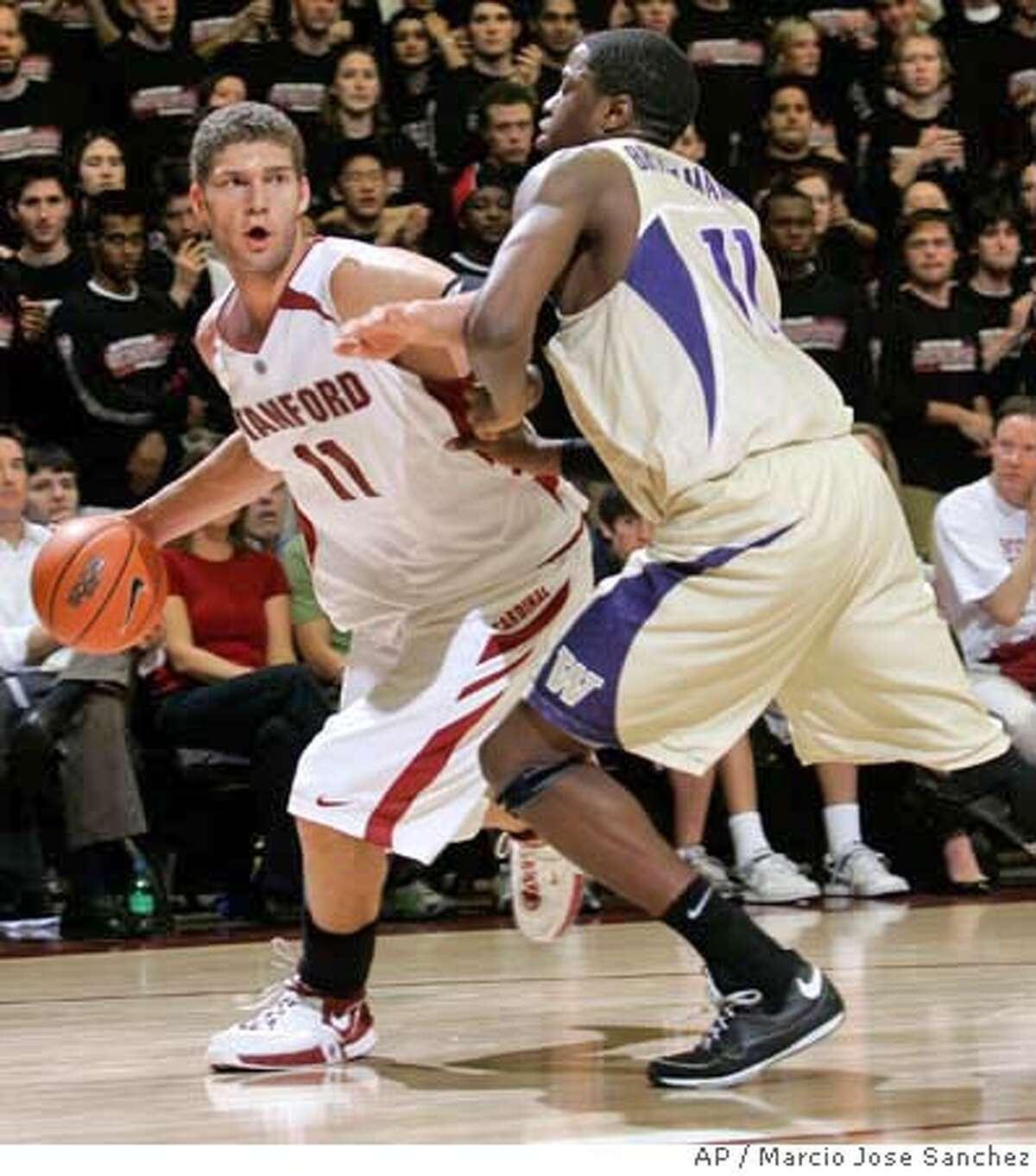 ###Live Caption:Stanford's Brook Lopez, left, is defended by Washington's Matthew Bryan-Amaning in the second half of a college basketball game in Stanford, Calif., Thursday, Feb. 28, 2008. Stanford won 82-79. (AP Photo/Marcio Jose Sanchez)###Caption History:Stanford's Brook Lopez, left, is defended by Washington's Matthew Bryan-Amaning in the second half of a college basketball game in Stanford, Calif., Thursday, Feb. 28, 2008. Stanford won 82-79. (AP Photo/Marcio Jose Sanchez)###Notes:Brook Lopez, Mathew Bryan-Amaning###Special Instructions:EFE OUT