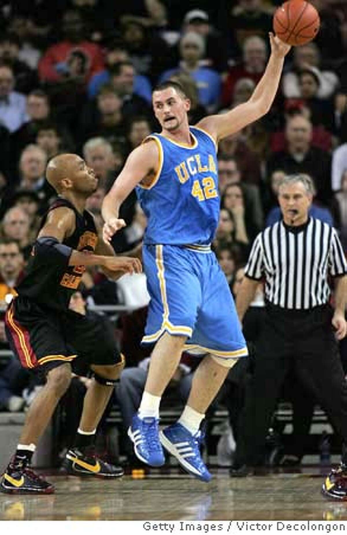 ###Live Caption:LOS ANGELES, CA - FEBRUARY 17: Kevin Love #42 of the UCLA Bruins gets the ball in the low post against Taj Gibson #22 of the USC Trojans in the first half during their Pac-10 Conference game at the Galen Center on February 17, 2008 in Los Angeles, California. (Photo by Victor Decolongon/Getty Images)###Caption History:LOS ANGELES, CA - FEBRUARY 17: Kevin Love #42 of the UCLA Bruins gets the ball in the low post against Taj Gibson #22 of the USC Trojans in the first half during their Pac-10 Conference game at the Galen Center on February 17, 2008 in Los Angeles, California. (Photo by Victor Decolongon/Getty Images)###Notes:UCLA v USC###Special Instructions: