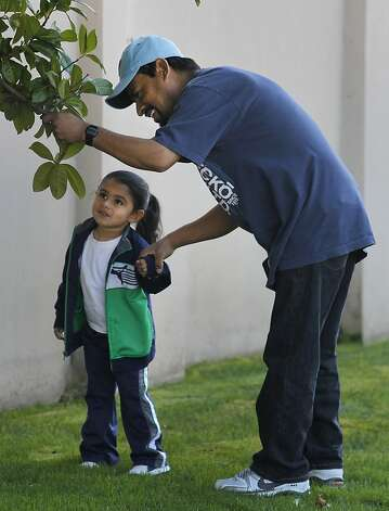 Jesus Navarro walks with his 3-year-old daughter Karin Jacquelin after discussing his need for a kidney transplant in Berkeley, Calif. on Thursday, Feb. 9, 2012. However, Navarro's immigration status may create complications in his receiving publicly-assisted post-op medical care. Photo: Paul Chinn, The Chronicle