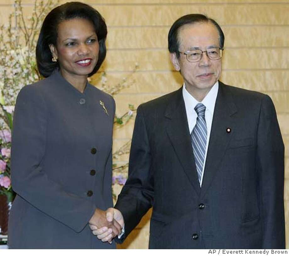 U.S. Secretary of State Condoleezza Rice, left, shakes hands with Japanese Prime Minister Yasuo Fukuda at the latter's official residence in Tokyo, Wednesday, Feb. 27, 2008. Rice ordered a top Asia diplomat to stay in China on Wednesday to look at fresh ways of unblocking the stalled effort to get North Korea to abandon nuclear weapons. (AP Photo/Everett Kennedy Brown, Pool) POOL PHOTO Photo: Everett Kennedy Brown