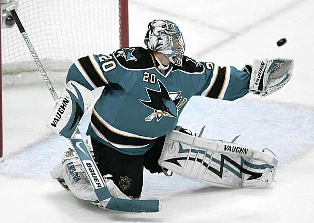 San Jose Sharks goalie Evgeni Nabokov (20), of Kazakhstan, blocks a shot by a Anaheim Ducks player in the second period of a first-round NHL hockey playoff game Saturday, April 25, 2009, in San Jose, Calif. (AP Photo/Paul Sakuma)