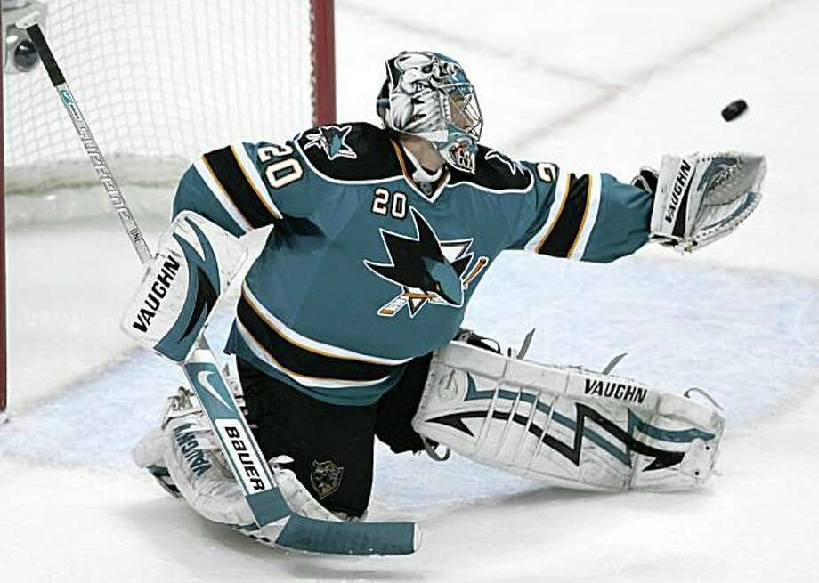 San Jose Sharks goalie Evgeni Nabokov (20), of Kazakhstan, blocks a shot by a Anaheim Ducks player in the second period of a first-round NHL hockey playoff game Saturday, April 25, 2009, in San Jose, Calif. (AP Photo/Paul Sakuma) Photo: Paul Sakuma, AP