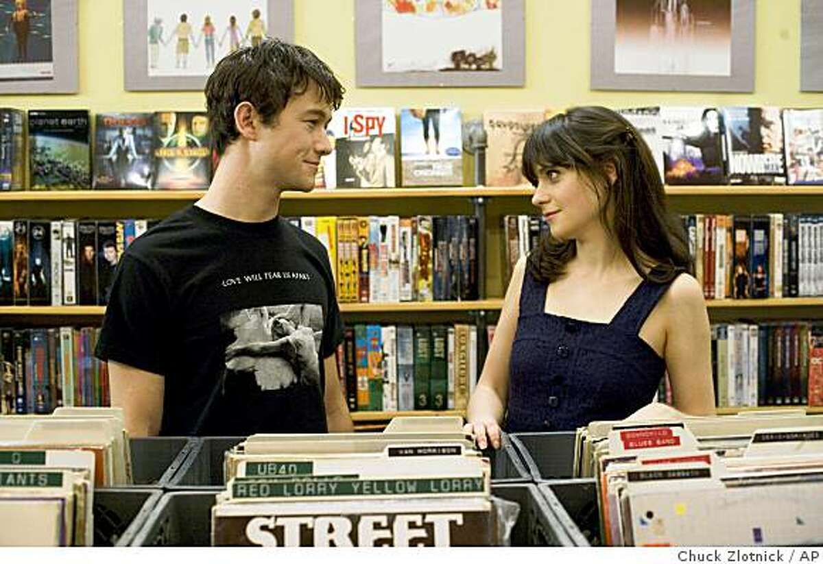 In this film publicity still released by Fox Searchlight, Joseph Gordon-Levitt, left, and Zooey Deschanel are shown in a scene from