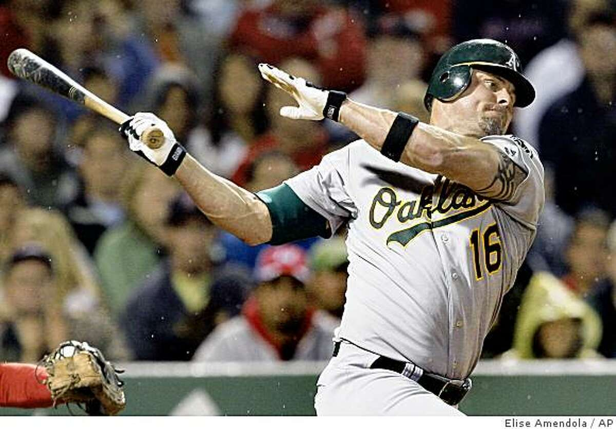 Oakland Athletics' Jason Giambi strikes out swinging against Boston Red Sox closer Jonathan Papelbon in the ninth inning of their baseball game at Fenway Park in Boston Tuesday, July 7, 2009. The Red Sox won 5-2. (AP Photo/Elise Amendola)