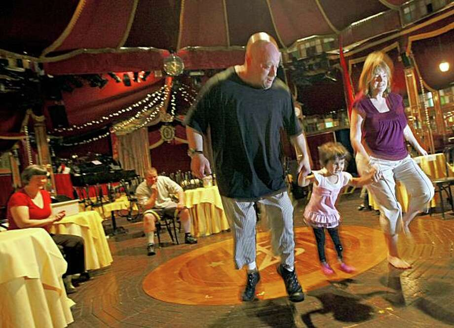 Peter Pitofsky a clown for Teatro ZinZanniÕs helps Elyse Roberts-Marino age 2 and her mother Jillian Roberts skip across the stage as Pitofsky leads a clown class offered this summer at the theaters tent on San Francisco's Embarcadero. Saturday June 20, 2009 Photo: Lance Iversen, The Chronicle
