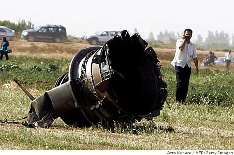 Part of the Caspian Airlines plane, which fell into farmland near the city of Qazvin, northwest of Tehran, is seen at the crash site. Photo: Atta Kenare, AFP/Getty Images