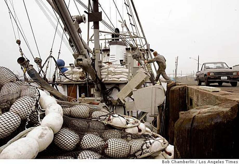 "Nick Jurlin Jr., whose grandparents and father also worked in the local fishing industry, boards his boat, the Eileen, in San Pedro, Calif. ""It would be heartbreaking to see this all go away,"" he said. Illustrates CALIF-FISHERMEN (category a) by Ronald D. White (c) 2009, Los Angeles Times. Moved Tuesday, July 14, 2009. (MUST CREDIT:  Los Angeles Times photo by Bob Chamberlin.) Photo: Bob Chamberlin, Los Angeles Times"