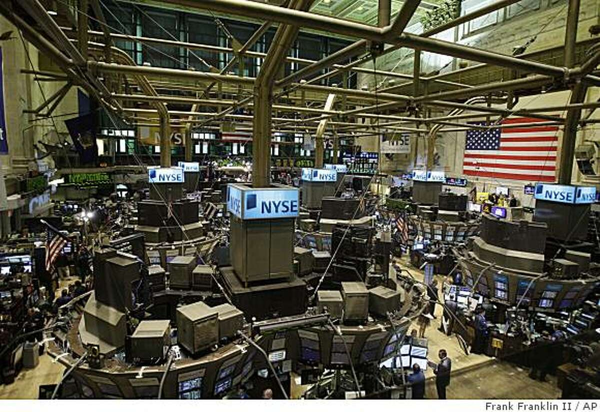 Traders work the floor of the New York Stock Exchange Wednesday, July 15, 2009 in New York. Stocks surged for the second time in three days Wednesday as investors pounce on more evidence that the economy might not be as weak as feared. (AP Photo/Frank Franklin II)