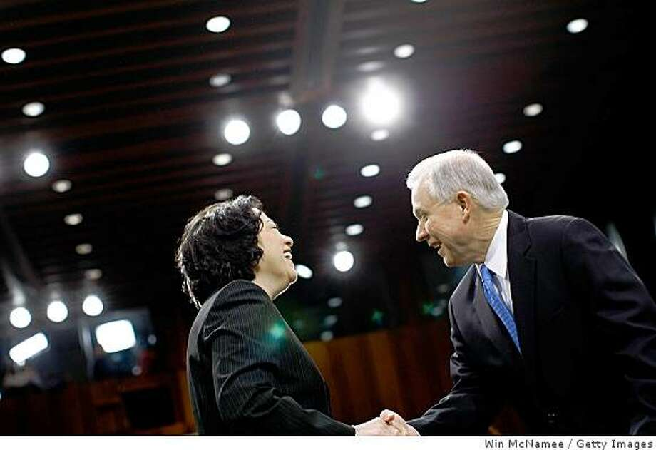 WASHINGTON - JULY 15:  Supreme Court nominee Judge Sonia Sotomayor (L) greets Senate Judiciary Committee ranking member Sen. Jeff Sessions (R-AL) (R) as she arrives for the third day of confirmation hearings before the Senate Judiciary Committee July 15, 2009 in Washington, DC. Sotomayor faces a day of questioning from Senators on the committee and also a closed session.  (Photo by Win McNamee/Getty Images) Photo: Win McNamee, Getty Images