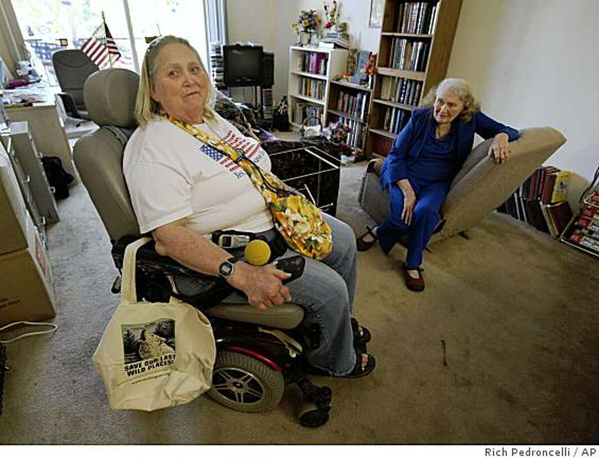 Carin Kay Martin, 55, left, is seen with her mother, Jessie Martin, 88, who suffers from Alzheimer's, in the apartment they share in Sacramento, Calif., Wednesday, July 8, 2009. Martin, who receives state in-home care support, was among a group of protestors who blocked Gov. Arnold Schwarzengger's Capitol office on Tuesday in a demonstration against his proposed cuts to welfare and other social programs. Martin a former carpenter who suffers from severe gout, said the governor's proposals would take away her caregiver and reduce the state's contribution to her Social Security disability benefits.(AP Photo/Rich Pedroncelli)