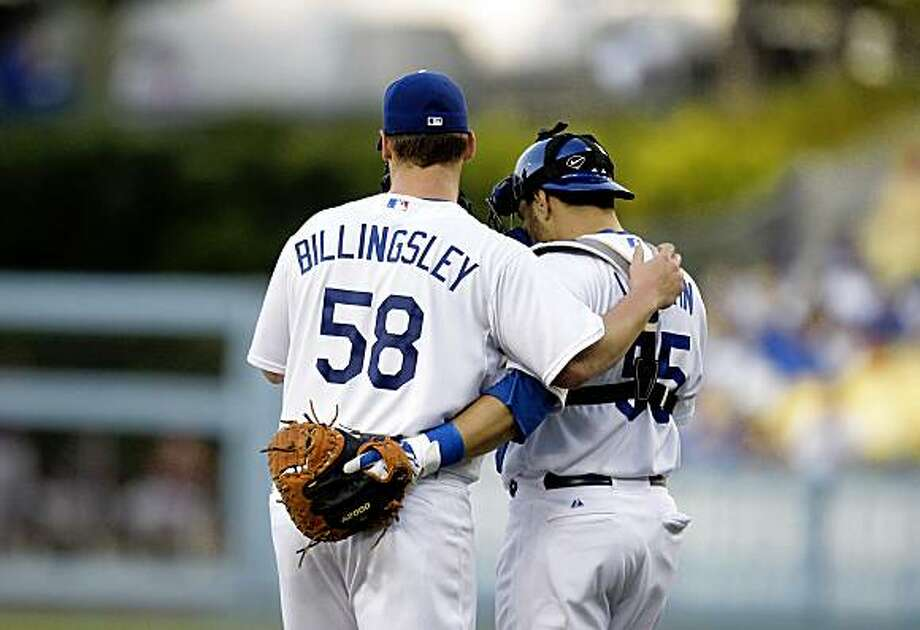 Los Angeles Dodgers starting pitcher Chad Billingsley, left, talks to catcher Russell Martin during the first inning of a baseball game against the Houston Astros in Los Angeles, Friday, July 17, 2009. (AP Photo/Jae C. Hong) Photo: Jae C. Hong, AP