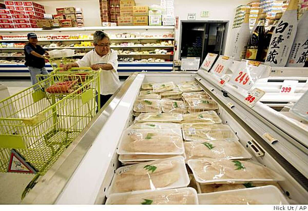In a Thursday, June 4, 2009 photo, Shoppers check out rows of iceboxes stacked with seafood at Thuan Phat market in Westminster, Calif. State and county authorities are inspecting Asian markets in Southern California to try to weed out the sale of white croaker, which has been contaminated by chemicals released into the Pacific Ocean from the 1950s to the 1970s. (AP Photo/Nick Ut)
