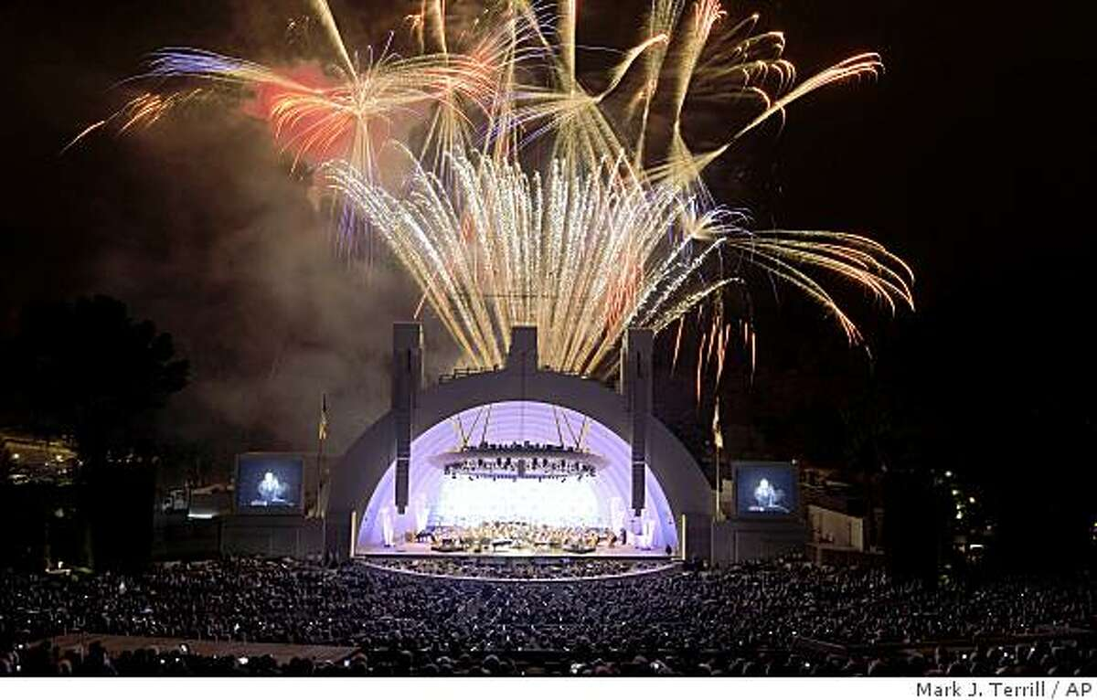 Fireworks ignite above the stage during opening night at the Hollywood Bowl, Friday, June 19, 2009, in Los Angeles. (AP Photo/Mark J. Terrill)