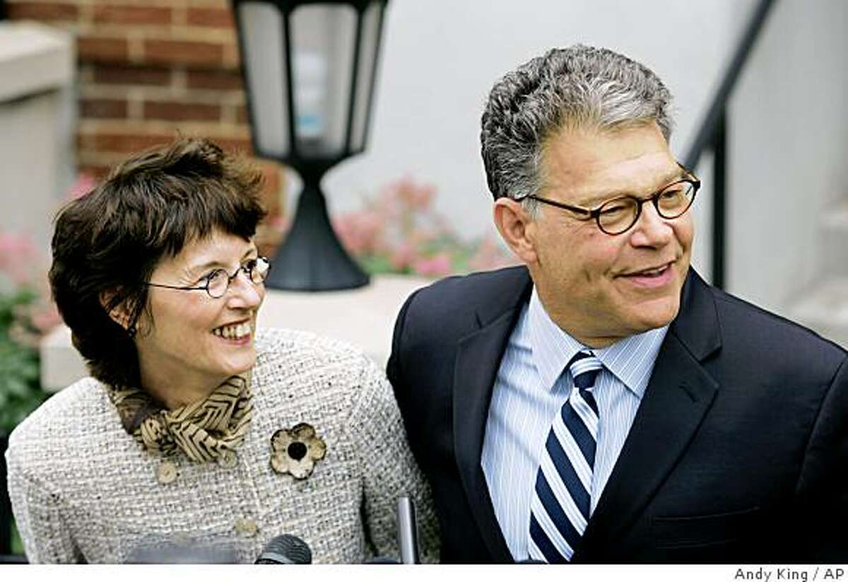 Democrat Al Franken, right, with his wife Frannie Franken smile as they meet the media at their house in MInneapolis Tuesday June 30, 2009 after the Minnesota Supreme Court ruled in favor of the Democrat in the Senate race against Republican Norm Coleman. (AP Photo/Andy King)
