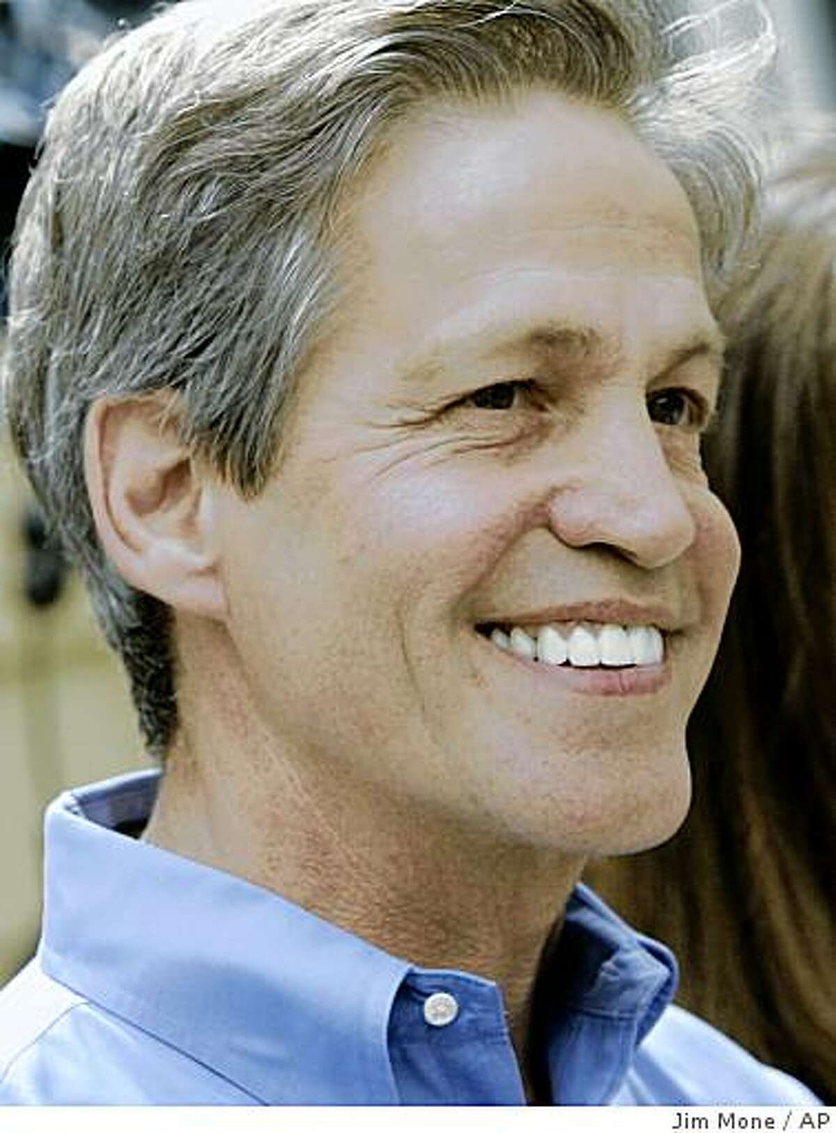 Former Republican Sen. Norm Coleman smiles as he addressed the media Tuesday, June 30, 2009 at his St. Paul, Minn., home after the Minnesota Supreme Court ruled that Democrat Al Franken won the contested U.S. Senate race in Minnesota. (AP Photo/Jim Mone)